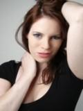 Adrienne McQueen profil resmi