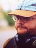 Christian McIntire profil resmi